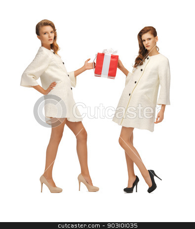 two teenage girls in white coats with present box stock photo, picture of two teenage girls in white coats with present box by Syda Productions