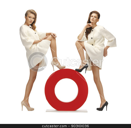 two teenage girls with o letter stock photo, two lovely teenage girls in white coats with o letter by Syda Productions