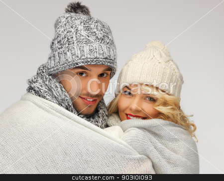 family couple under warm blanket stock photo, bright picture of family couple under warm blanket by Syda Productions