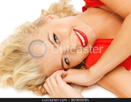 lying pensive beautiful woman stock photo, bright picture of lying pensive beautiful woman by Syda Productions