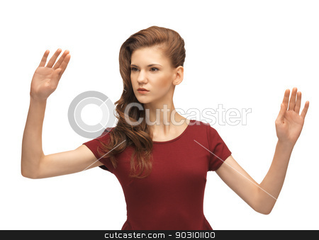 girl in red dress working with something imaginary stock photo, picture of teenage girl in red dress working with something imaginary by Syda Productions