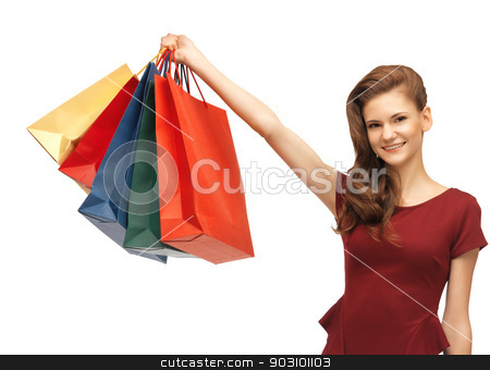 happy teenage girl with shopping bags stock photo, picture of happy teenage girl with shopping bags by Syda Productions
