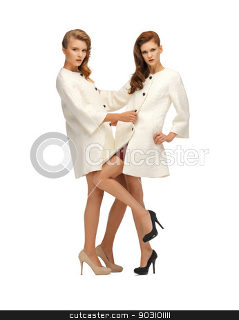 two lovely teenage girls in white coats stock photo, picture of two lovely teenage girls in white coats by Syda Productions
