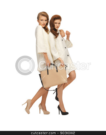 two teenage girls in white coats with bag stock photo, picture of two teenage girls in white coats with bag by Syda Productions