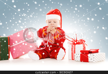 santa helper baby with christmas gifts stock photo, picture of santa helper baby with christmas gifts by Syda Productions