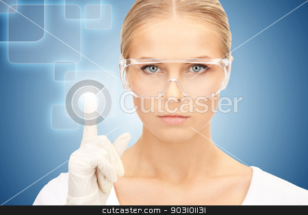 woman working with virtual screen stock photo, woman in protective glasses and gloves working with virtual screen by Syda Productions