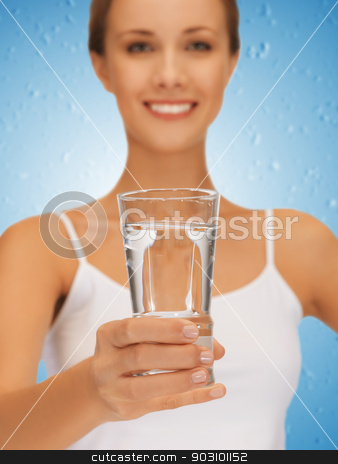 woman hands holding glass of water stock photo, closeup picture of woman hands holding glass of water . by Syda Productions