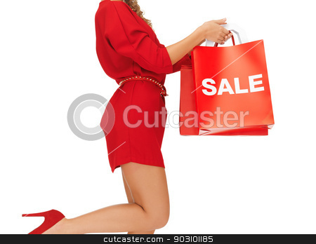 woman holding shopping bags stock photo, closeup picture of woman holding shopping bags by Syda Productions