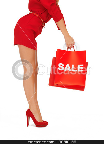 woman on high heels holding shopping bags stock photo, closeup picture of woman on high heels holding shopping bags by Syda Productions