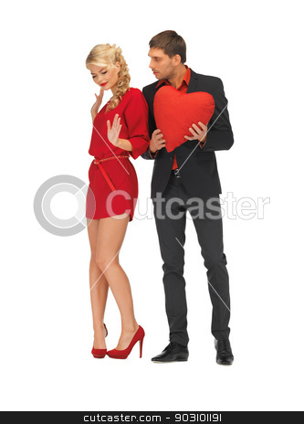 beautiful couple holding big heart stock photo, bright picture of beautiful couple holding big heart by Syda Productions