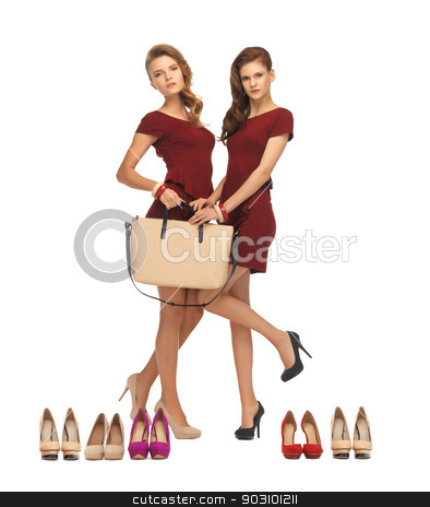 two teenage girls in red dresses with bag stock photo, picture of two teenage girls in red dresses with bag by Syda Productions