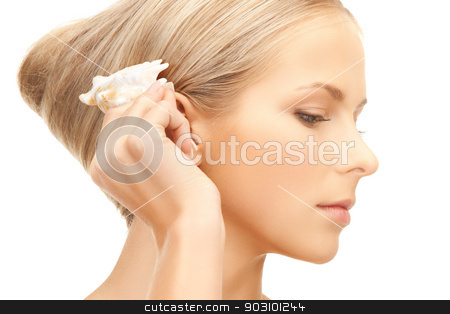 beautiful woman with seashell stock photo, bright closeup portrait picture of beautiful woman with seashell.. by Syda Productions