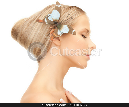 woman with butterfly in hair stock photo, picture of beautiful woman with butterfly in hair. by Syda Productions