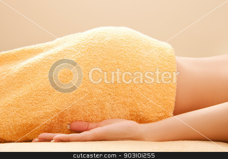woman lying on massage table stock photo, picture of woman lying on massage table by Syda Productions