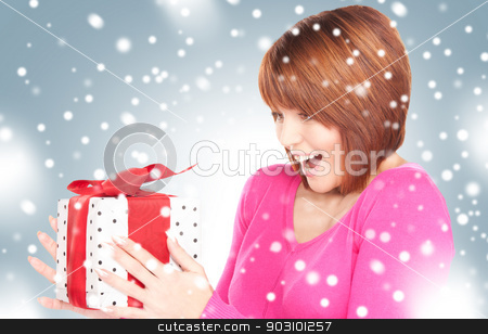 happy woman with gift box stock photo, picture of happy woman with gift box. by Syda Productions