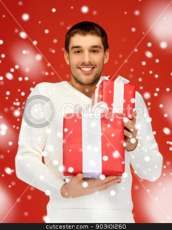man holding many gift boxes stock photo, bright picture of handsome man holding many gift boxes. by Syda Productions