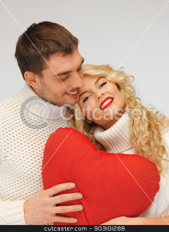 family couple in a sweaters with heart stock photo, picture of family couple in a sweaters with heart (focus on woman) by Syda Productions