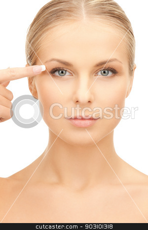 beautiful woman pointing to eye stock photo, picture of beautiful woman pointing to eye by Syda Productions