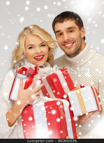 family couple in a sweaters with gift boxes stock photo, picture of family couple in a sweaters with gift boxes by Syda Productions