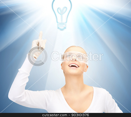 woman in protective glasses and gloves stock photo, picture of woman in protective glasses and gloves showing idea concept by Syda Productions