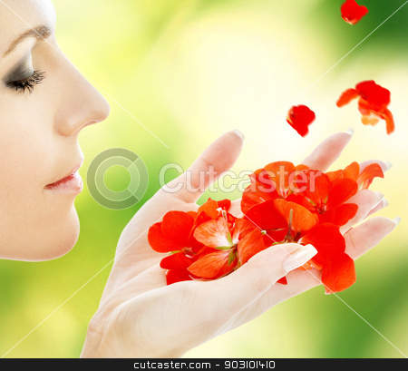 red petals stock photo, lovely woman with red flower petals in spa by Syda Productions