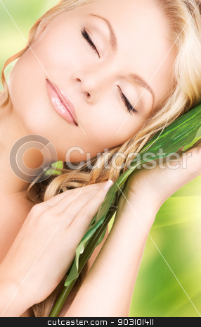 woman with green leaf stock photo, picture of woman with green leaf with eyes closed by Syda Productions