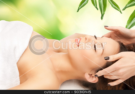 beautiful woman in massage salon stock photo, picture of beautiful woman in massage salon by Syda Productions