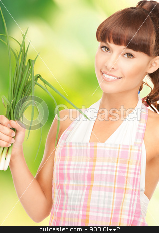 beautiful housewife with spring onions over green stock photo, bright picture of beautiful housewife with spring onions over green. by Syda Productions