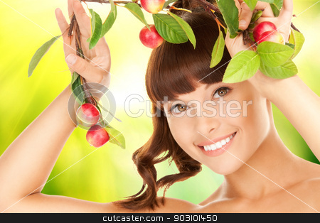 lovely woman with apple twig stock photo, picture of lovely woman with apple twig by Syda Productions