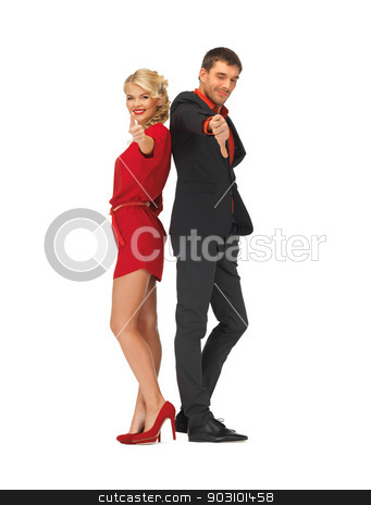 man and woman showing thumbs up, down stock photo, picture of man and woman showing thumbs up, down by Syda Productions