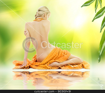 beautiful woman in spa with towels stock photo, beautiful woman in spa with towels over green by Syda Productions