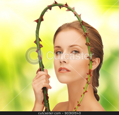 woman holding branch with thorns stock photo, picture of lovely woman holding branch with thorns. by Syda Productions