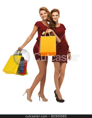 teenage girls in red dresses with shopping bags stock photo, picture of two teenage girls in red dresses with shopping bags by Syda Productions