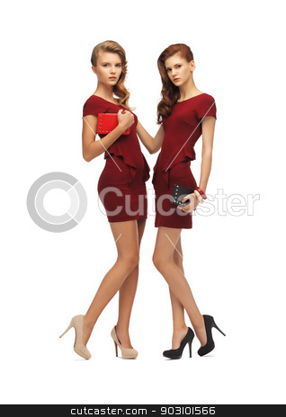 two teenage girls in red dresses with clutches stock photo, picture of two teenage girls in red dresses with clutches by Syda Productions