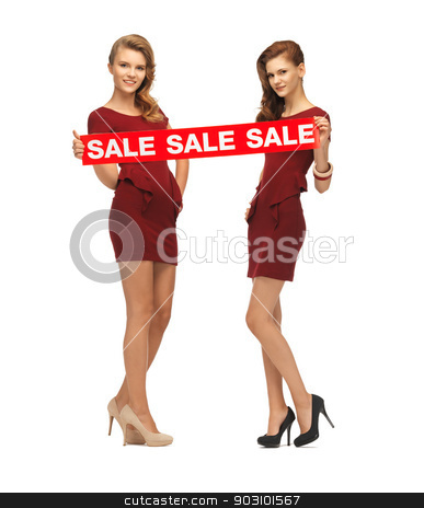 teenage girsl in red dresses with sale sign stock photo, picture of teenage girsl in red dresses with sale sign by Syda Productions