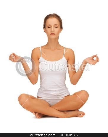 woman in undrewear practicing yoga lotus pose stock photo, sporty woman in cotton undrewear practicing yoga lotus pose by Syda Productions