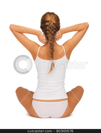 woman in undrewear practicing yoga lotus pose stock photo, sporty woman in cotton undrewear practicing yoga lotus pose by Syda Productions