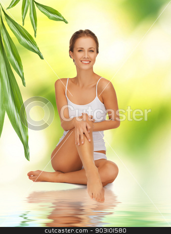 woman in cotton undrewear touching her legs stock photo, picture of beautiful woman in cotton undrewear touching her legs by Syda Productions