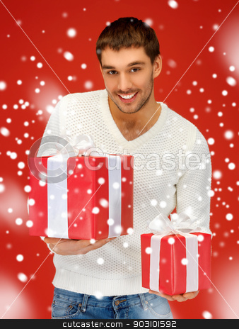 man holding many gift boxes stock photo, bright picture of handsome man holding many gift boxes. by Syda Productions