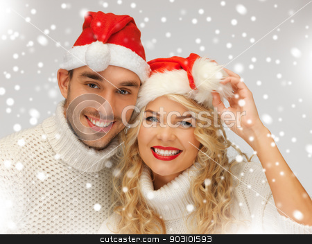 family couple in sweaters and santa's hats stock photo, picture of family couple in sweaters and santa's hats by Syda Productions
