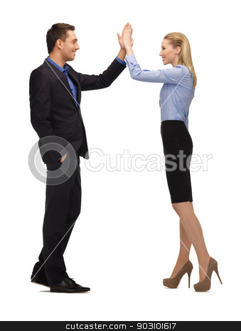 man and woman giving a high five stock photo, bright picture of man and woman giving a high five. by Syda Productions
