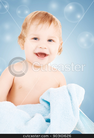 baby with blue towel stock photo, picture of baby boy with blue towel and soap bubbles by Syda Productions