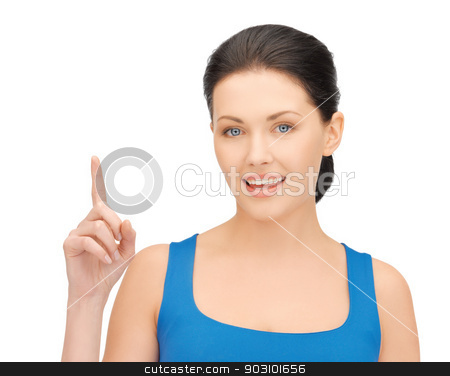 beautiful woman pointing her finger stock photo, bright picture of beautiful woman pointing her finger by Syda Productions