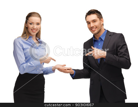 man and woman showing something on the palms stock photo, bright picture of man and woman showing something on the palms by Syda Productions