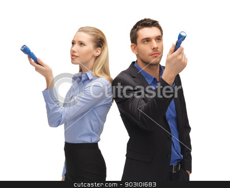 man and woman with flashlights stock photo, bright picture of man and woman with flashlights. by Syda Productions