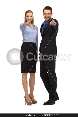 man and woman pointing their fingers stock photo, bright picture of man and woman pointing their fingers. by Syda Productions