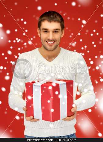 handsome man with a gift stock photo, bright picture of handsome man with a gift . by Syda Productions