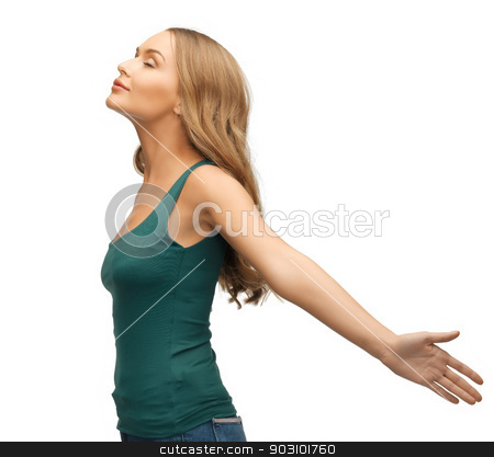 woman spreading hands stock photo, picture of calm and serious woman spreading hands. by Syda Productions