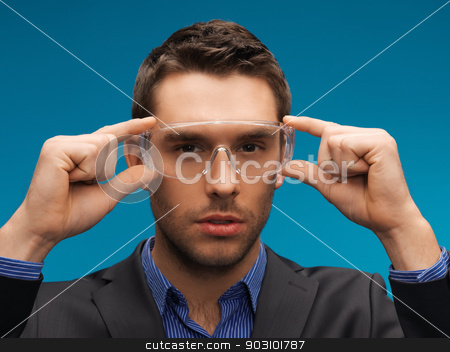 businessman in protective glasses stock photo, picture of handsome businessman in protective glasses. by Syda Productions