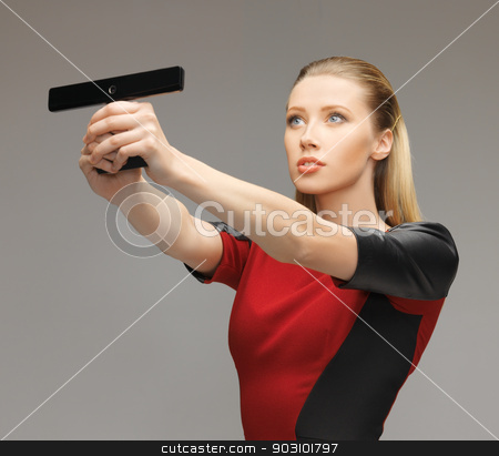 futuristic woman with gadget stock photo, bright picture of futuristic woman with gadget by Syda Productions